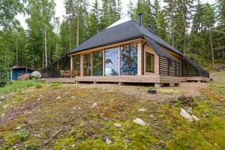 Architect Paolo Caravello of Helsinki-based practice Void created this prism-shaped house near a lake in Sysmä, Finland, with a glass-topped pyramidal roof that transformed the top level of the house into a fully glazed observatory where its owners can look out to stunning views of nature.