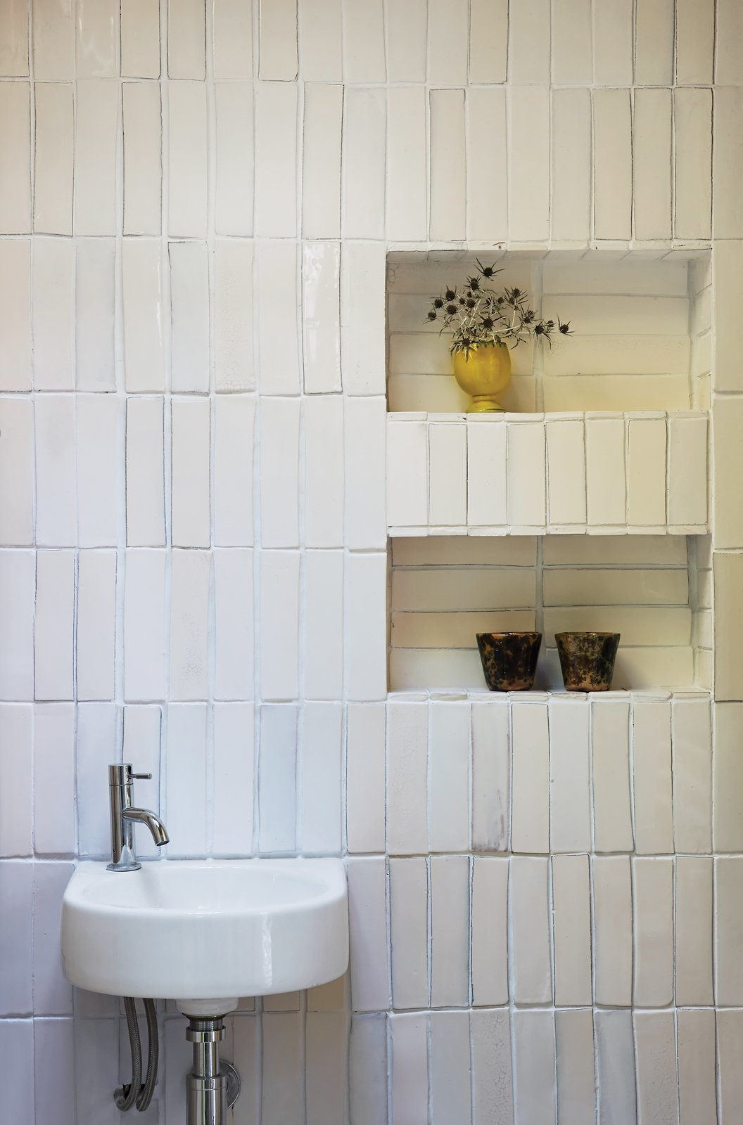 Bath Room and Wall Mount Sink If you don't have to have cabinetry installed or shelves drilled onto your bathroom walls, one good idea is to create recessed wall shelves for storage. This will help conserve floor space. You can even create recessed wall in corners.  Photo 6 of 8 in 8 Bathroom Storage Hacks You Probably Haven't Tried Yet