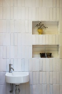 If you don't want to have cabinetry installed, or built-in shelves on your bathroom walls, one good idea is to create recessed walls for storage. This will help conserve floor space, and you can even create a recessed wall in corners.