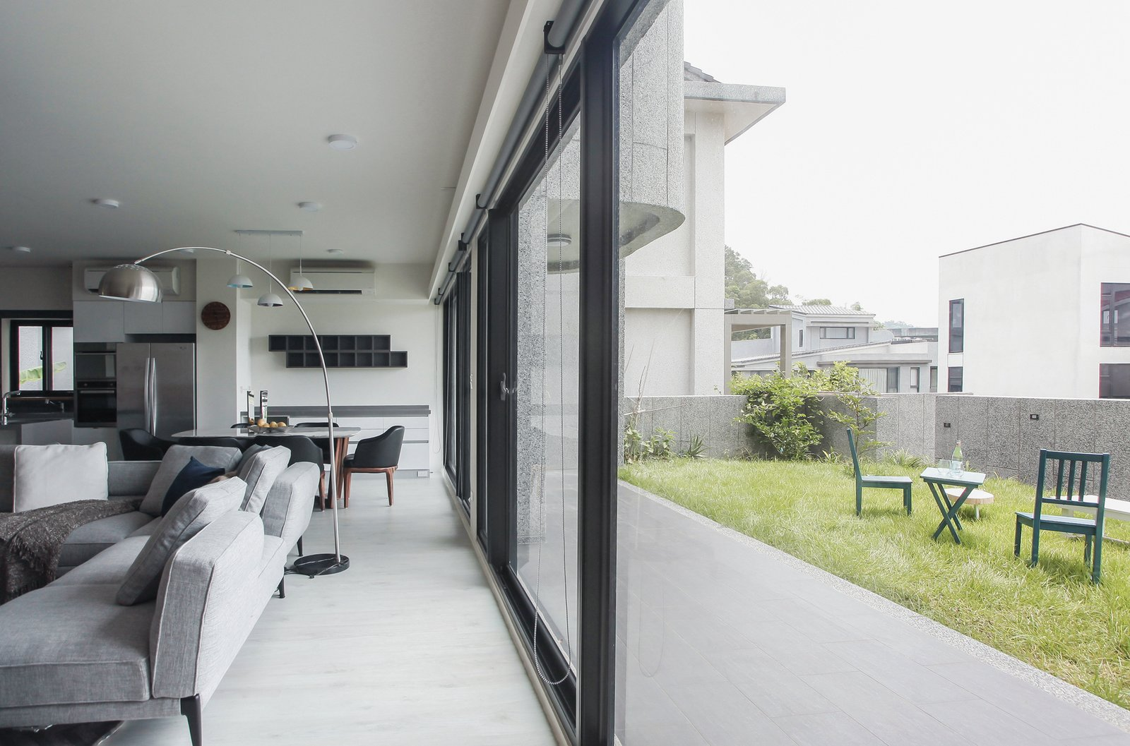 Windows and Sliding Window Type  Photo 5 of 15 in A Serpentine Wall in This Taiwanese Home Divides Public and Private Space