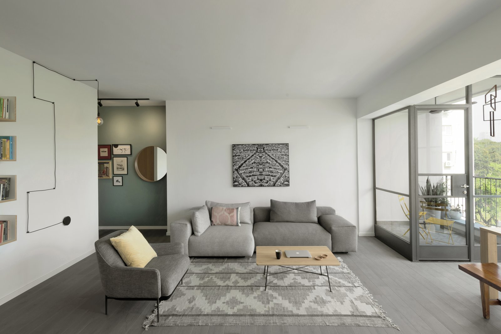 Living, Rug, Chair, Shelves, Wall, Pendant, Coffee Tables, Sofa, Light Hardwood, and Track  Best Living Track Shelves Photos from Graphic Design Guides an Apartment Renovation in Tel Aviv