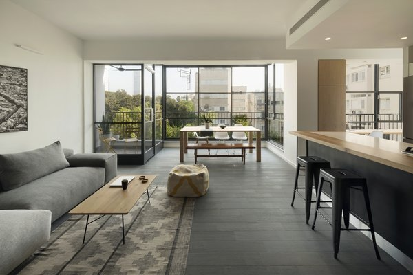 Living, Chair, Coffee Tables, Light Hardwood, Ottomans, Sofa, Recessed, Rug, Wall, Stools, Bar, and Bench  Best Living Bar Coffee Tables Bench Photos from Graphic Design Guides an Apartment Renovation in Tel Aviv