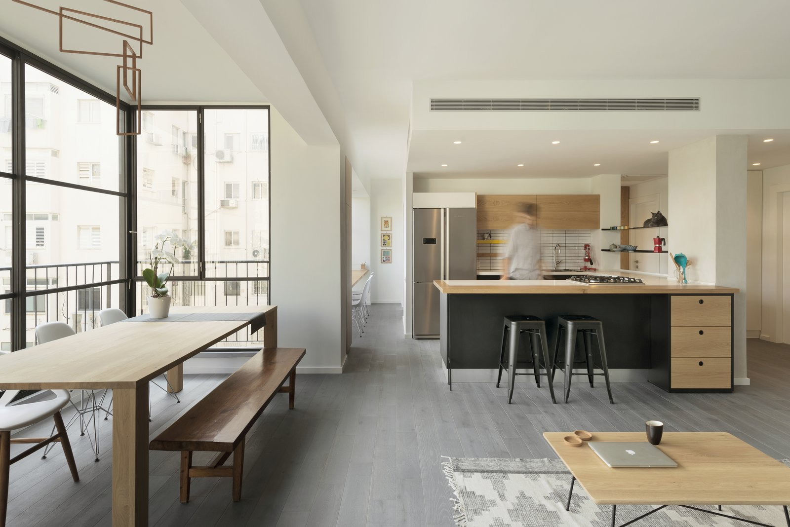 Dining Room, Recessed Lighting, Light Hardwood Floor, Bar, Chair, Rug Floor, Stools, Table, and Bench  Photo 5 of 14 in Graphic Design Guides an Apartment Renovation in Tel Aviv