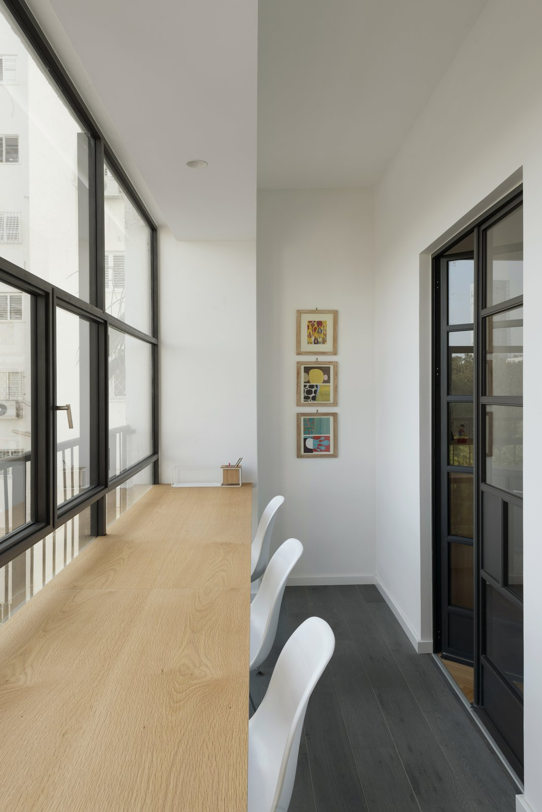 Office, Desk, Light Hardwood Floor, and Chair  Photo 6 of 14 in Graphic Design Guides an Apartment Renovation in Tel Aviv