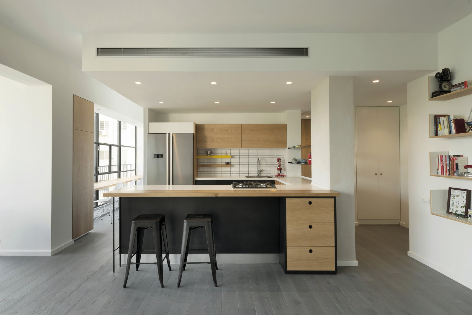 Dining Room, Stools, Bar, Light Hardwood Floor, Shelves, and Recessed Lighting  Photo 7 of 14 in Graphic Design Guides an Apartment Renovation in Tel Aviv