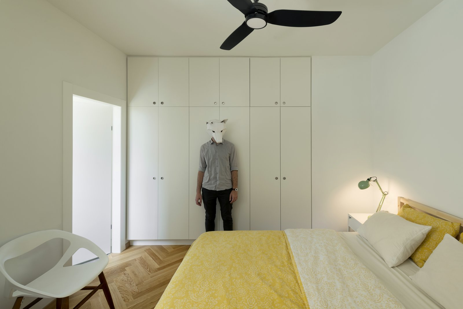 Bedroom, Light Hardwood Floor, Table Lighting, Lamps, Chair, Bed, Wardrobe, and Night Stands  Photo 8 of 14 in Graphic Design Guides an Apartment Renovation in Tel Aviv
