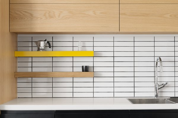 Kitchen, Drop In Sink, Subway Tile Backsplashe, and Wood Cabinet  Photo 11 of 14 in Graphic Design Guides an Apartment Renovation in Tel Aviv