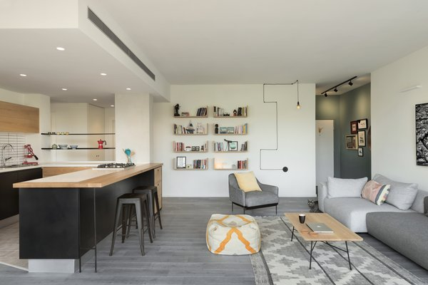 Living, Recessed, Sofa, Coffee Tables, Ottomans, Pendant, Light Hardwood, Rug, Stools, Bar, Shelves, Wall, and Track  Best Living Bar Recessed Photos from Graphic Design Guides an Apartment Renovation in Tel Aviv