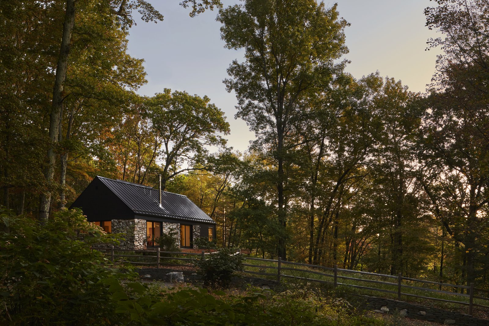 Exterior, Cabin Building Type, House Building Type, Metal Roof Material, Gable RoofLine, Stone Siding Material, and Wood Siding Material  Photo 3 of 13 in A Minimalist Retreat Rises From Old Stone Walls in Hudson Valley
