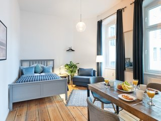 This serene one-bedroom apartment at the intersection of Friedrichshain and Kreuzberg is tastefully decorated in muted blues.