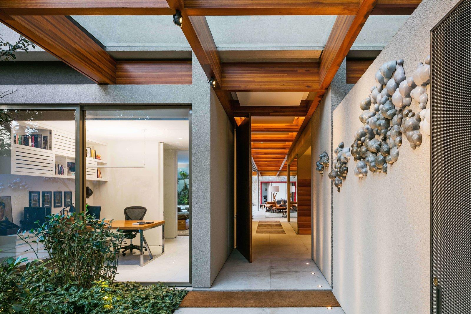 Doors, Exterior, Metal, and Swing Door Type  Best Photos from This Brilliant Brazilian Abode Was Designed Around an Imposing Tree