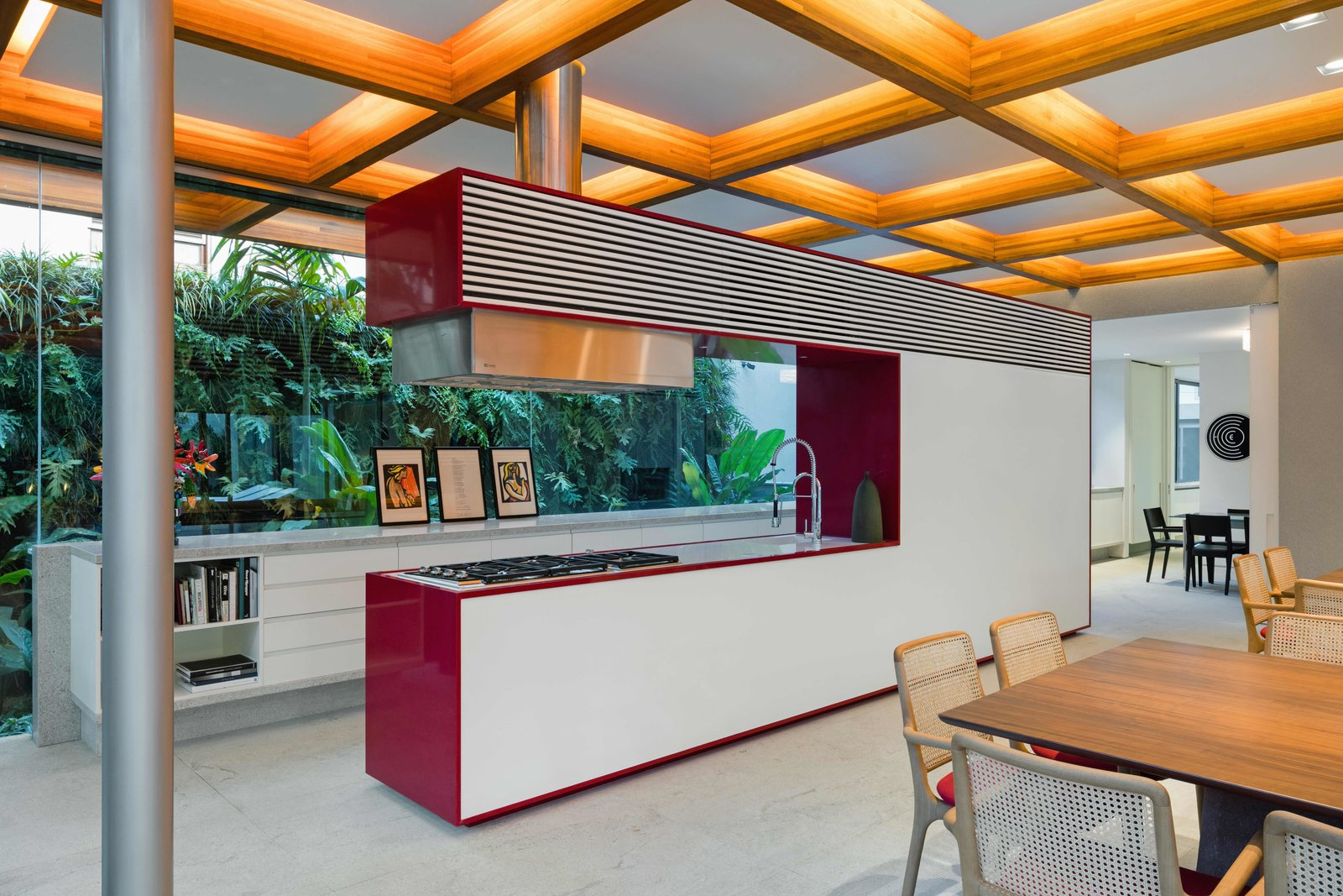Kitchen, Recessed Lighting, Colorful Cabinet, Concrete Floor, Range, Drop In Sink, White Cabinet, and Range Hood  Best Photos from This Brilliant Brazilian Abode Was Designed Around an Imposing Tree