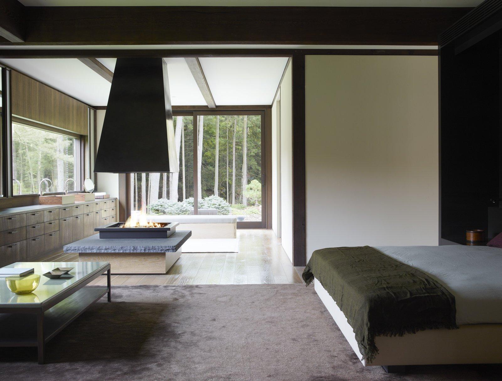 Bedroom, Bed, Medium Hardwood Floor, and Rug Floor  Photo 11 of 15 in Feast Your Eyes on Fashion Designer Josie Natori's Japanese-Inspired Home