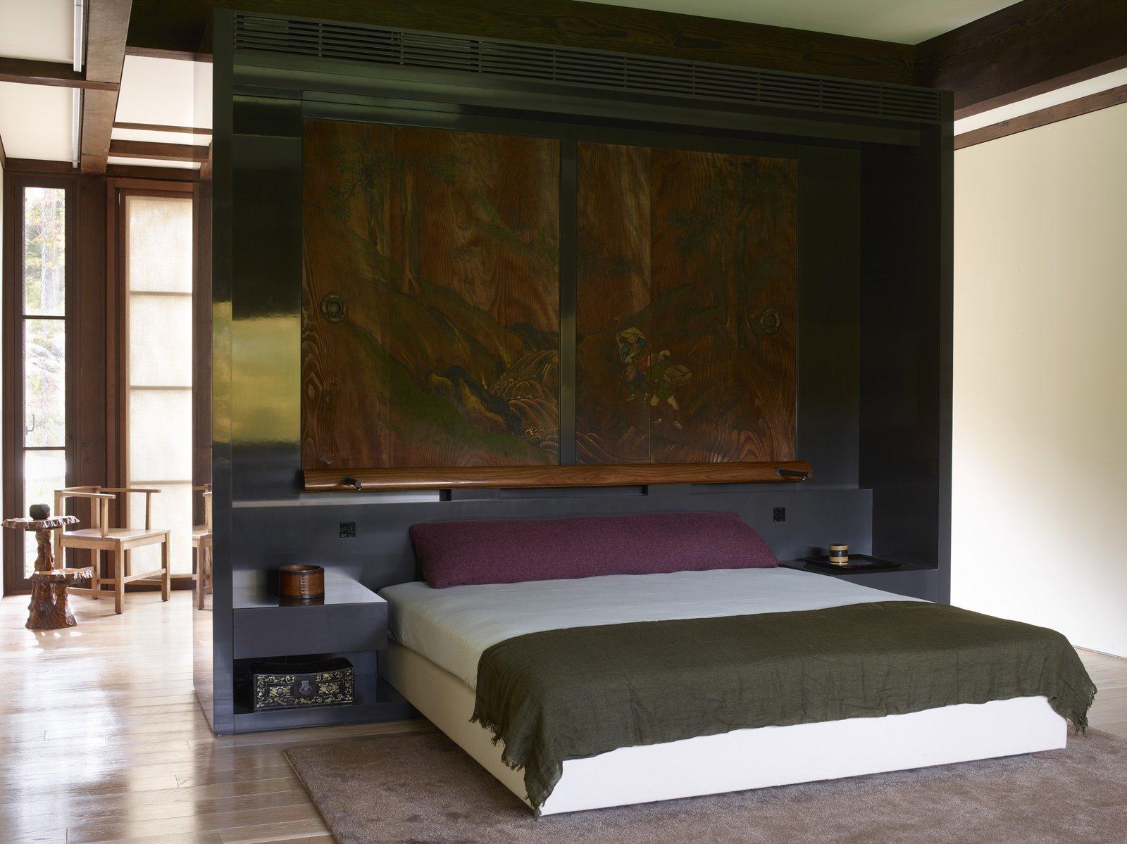 Bedroom, Bed, Medium Hardwood Floor, Rug Floor, and Night Stands  Photo 12 of 15 in Feast Your Eyes on Fashion Designer Josie Natori's Japanese-Inspired Home
