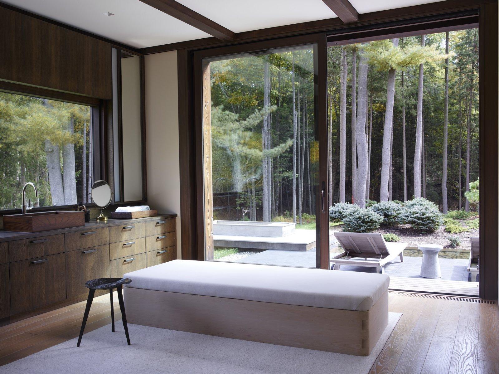 Bath Room, Wood Counter, Recessed Lighting, Medium Hardwood Floor, Vessel Sink, and Ceiling Lighting  Photo 15 of 15 in Feast Your Eyes on Fashion Designer Josie Natori's Japanese-Inspired Home