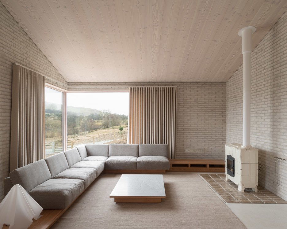 Living Room, Sectional, End Tables, Standard Layout Fireplace, Coffee Tables, and Rug Floor  Photo 21 of 21 in 10 Zen Homes That Champion Japanese Design