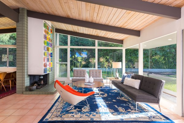 Living, Coffee Tables, Terra-cotta Tile, Rug, Corner, Chair, End Tables, Ceiling, Sofa, Table, Recessed, Lamps, and Wood Burning  Best Living Sofa Corner Wood Burning Photos from An Immaculate Midcentury Abode in San Diego Asks $1.55M