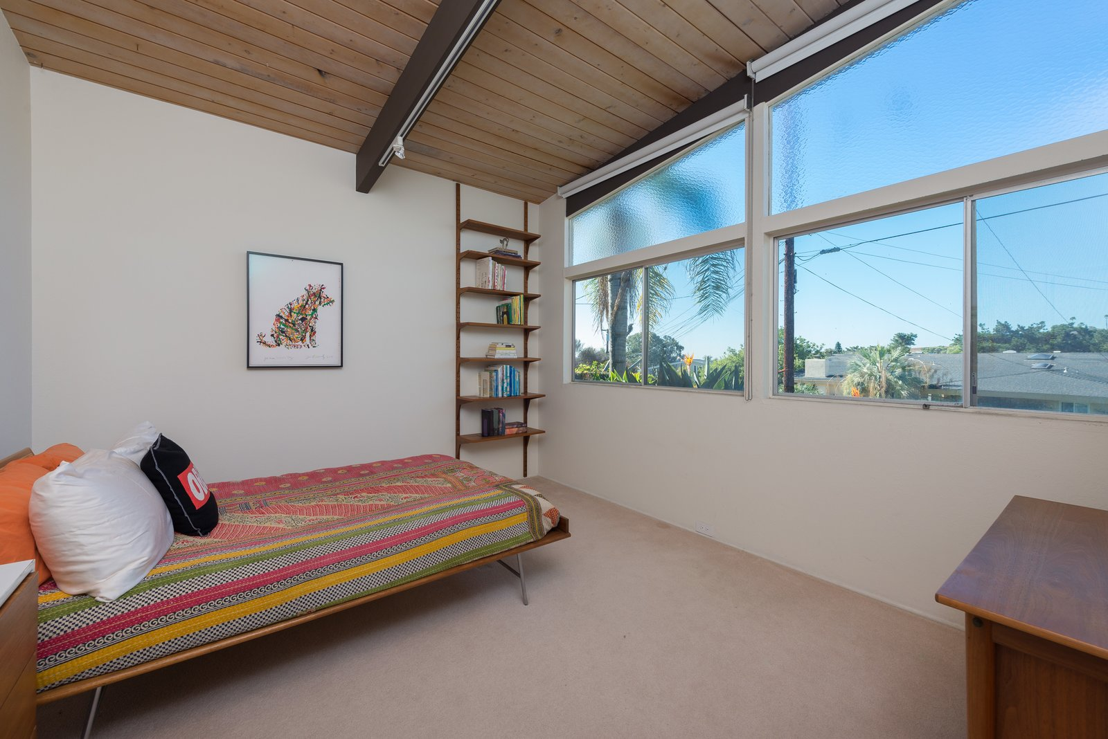 Bedroom, Bed, Dresser, Carpet, Track, and Shelves  Best Bedroom Track Dresser Photos from An Immaculate Midcentury Abode in San Diego Asks $1.55M