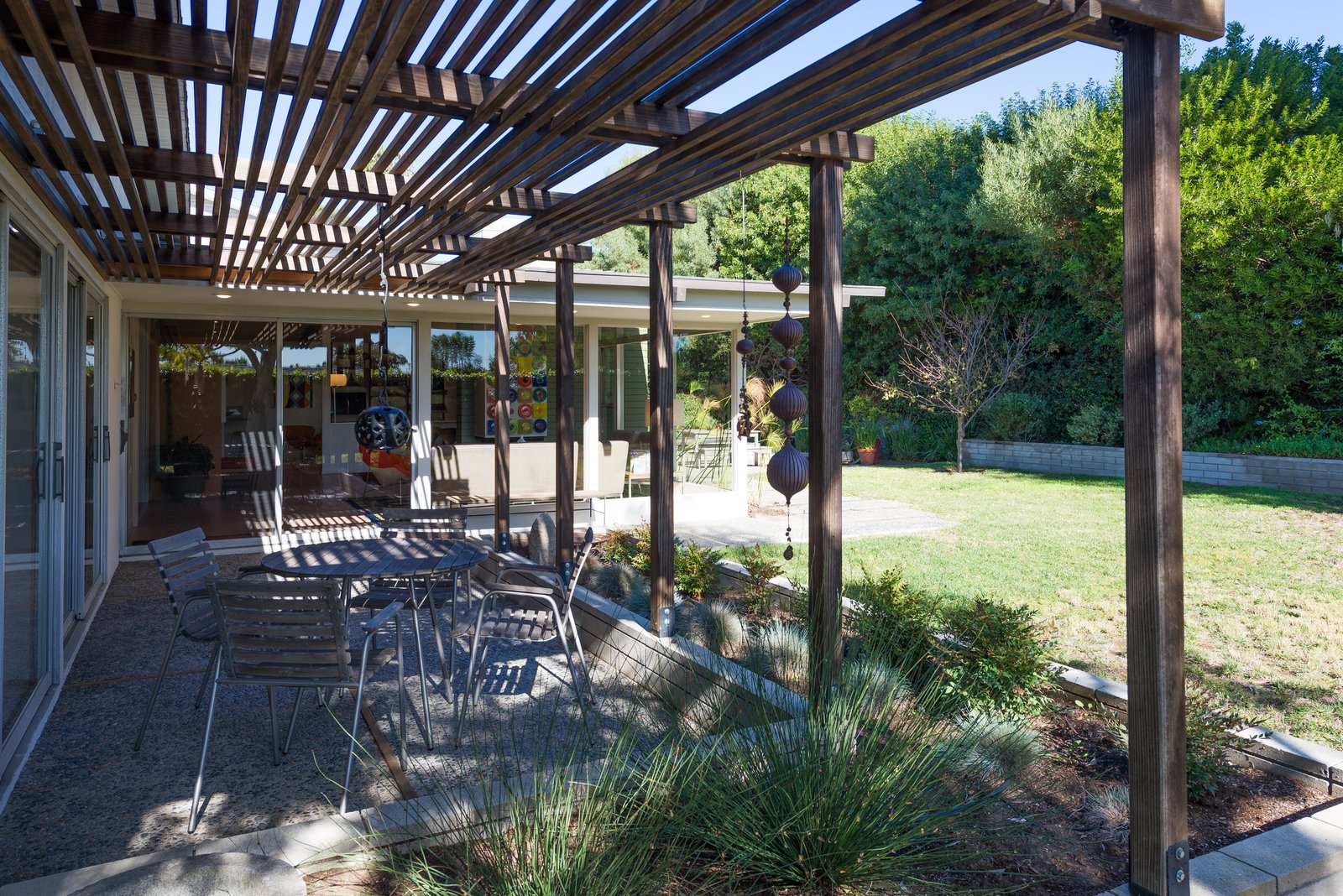 Outdoor, Back Yard, Walkways, Grass, Small, Side Yard, Raised Planters, Planters, and Trees  Best Outdoor Back Yard Planters Photos from An Immaculate Midcentury Abode in San Diego Asks $1.55M