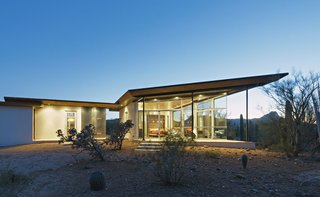 This house in Arizona's Sonoran Desert has concrete walls and floors and covered quartzite stone decks facing both the east and west.