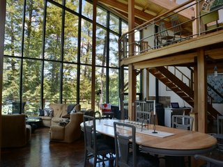 A home with tall glass walls near Lake Rosseau in Ontario, Canada