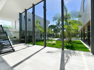 This holiday retreat in Cairns, Australia, has eight-meter-high glass windows and a 59-foot lap pool.