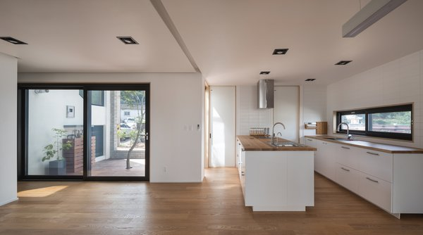 The kitchen and door that opens to a courtyard