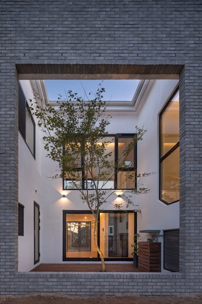Located on the south side of the house is internal courtyard with a large rectangular section cut out from the southern exterior wall.
