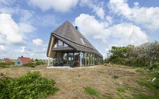 The abode's high roof was inspired by the De Waard Albatross tent.