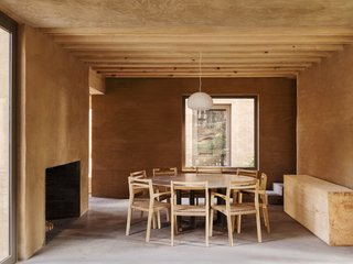 Five Cubist Hideaways Peek Out From a Mexican Pine Forest - Photo 12 of 17 - A minimalist dining table and large fireplace