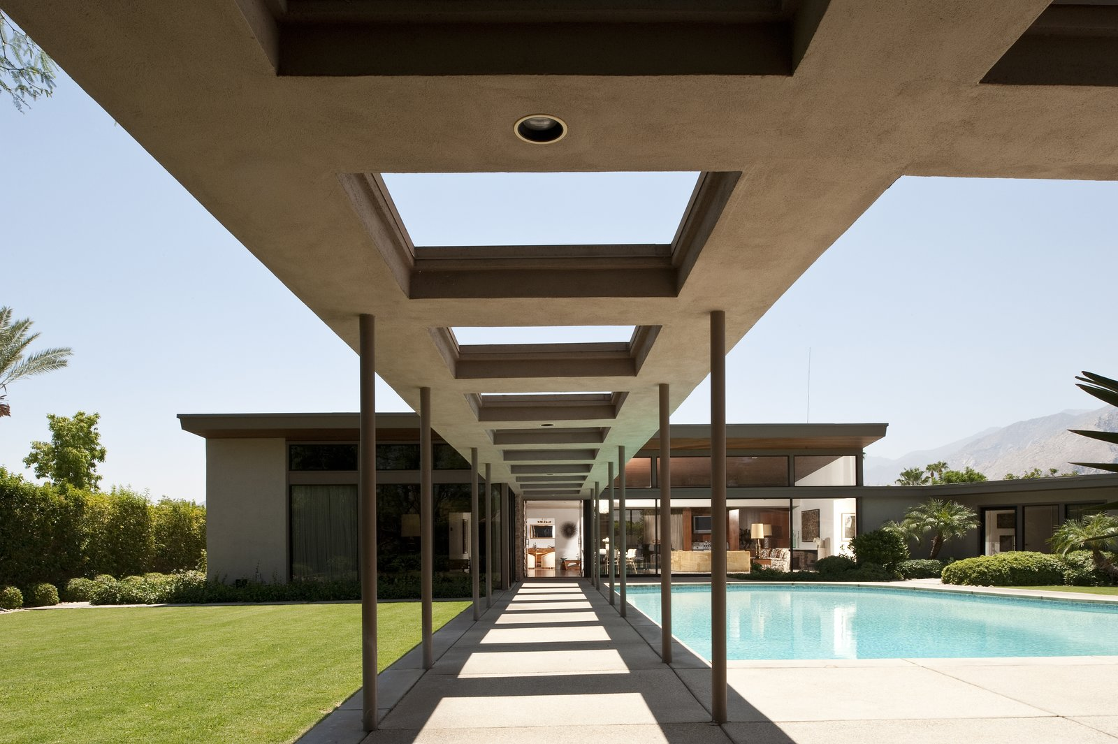 """Outdoor, Large Pools, Tubs, Shower, Grass, Swimming Pools, Tubs, Shower, and Concrete Patio, Porch, Deck Frank Sinatra's """"Twin Palms"""" Estate  Photo 7 of 10 in 10 Things You Shouldn't Miss at Modernism Week in Palm Springs"""