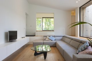 A Noguchi coffee table is a focal point in the living lounge.