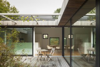 A Belgian Architect's Courtyard House Offers Work/Life Balance - Photo 3 of 13 - In the summer months, a grapevine in the courtyard provides shade.<br>