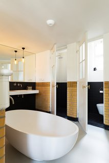 A 20th-Century Dutch Schoolhouse Now Holds a Series of Airy Lofts - Photo 9 of 13 -