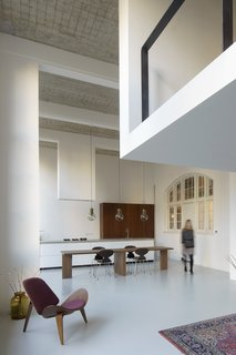 A 20th-Century Dutch Schoolhouse Now Holds a Series of Airy Lofts - Photo 6 of 13 - The kitchen and dining area