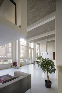 Over 16-foot-high ceilings allowed for the creation of new intermediate floors and intimate mezzanines.