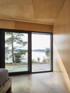 A bedroom enjoys views of the lake.
