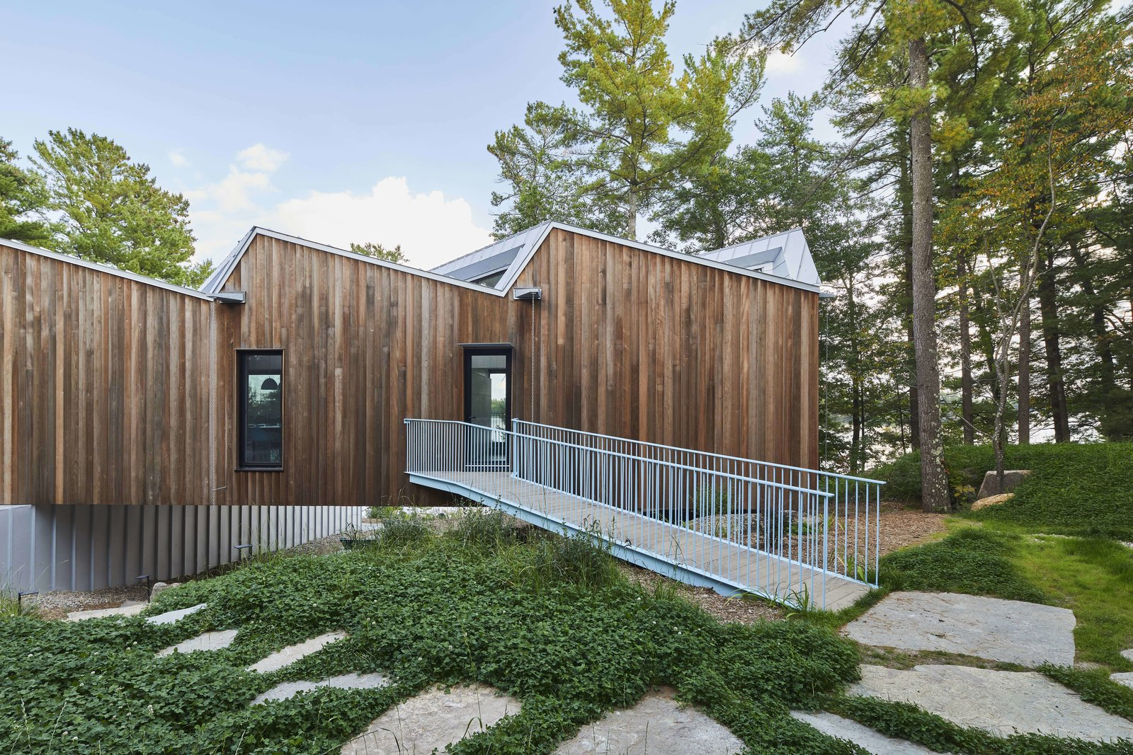 A net zero home in canada boasts a striking saw toothed for Net zero canada