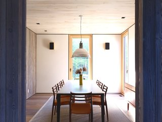 The owners also chose a suspension lamp by Fontana Arte to hang over the dining table.