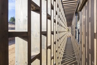 Large openings in the latticework facade brings in warming sunshine and fresh sea breezes.
