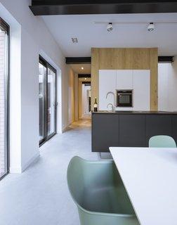 A sleek, streamlined open-concept kitchen.