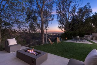 A stacked-stone fire pit and spectacular canyon views encourage outdoor living.