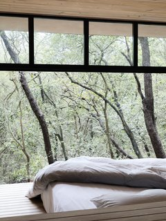 A peek at one of the bedrooms that looks out to the tree tops.