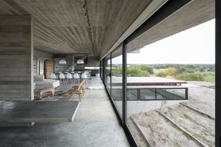 Layered concrete walls and ceilings add a raw masculinity to the interiors.