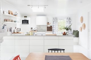 An expansive skylight brightens the kitchen.