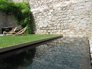 An old cistern found on the original site is now a black concrete pool.