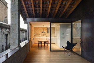 A spacious wood-decked veranda that's part of the duplex apartment.