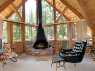 This rustic A-frame has stunning views, as well as a cozy wood-burning fireplace.