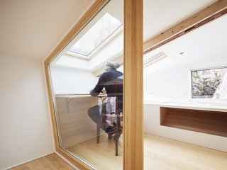 Before and After: A Renovated Artist's Studio Is Now an Airy, Efficient Home - Photo 11 of 16 - A skylight illuminates the retractable desk in the lofted workspace.