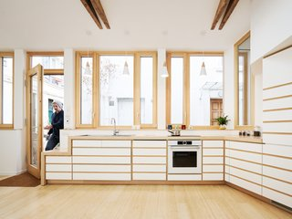 Before and After: A Renovated Artist's Studio Is Now an Airy, Efficient Home - Photo 7 of 16 - The white cabinetry with beech wood details adds a touch of Zen to the kitchen.